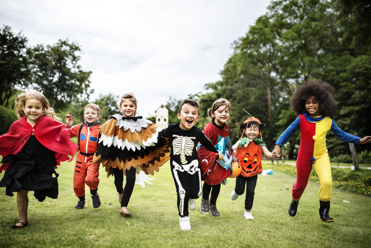 Group of little kids with autism in halloween costumes